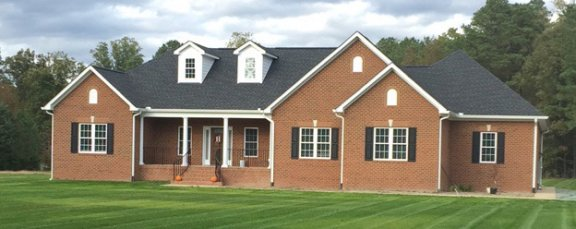 Finished custom house brick rancher elevation testimonial picture